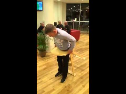 Man gets stuck in babies high chair