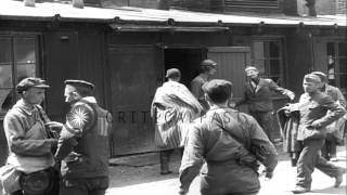 Liberated prisoners,security guards and priest at a barracks of Nazi prisoners, i...HD Stock Footage