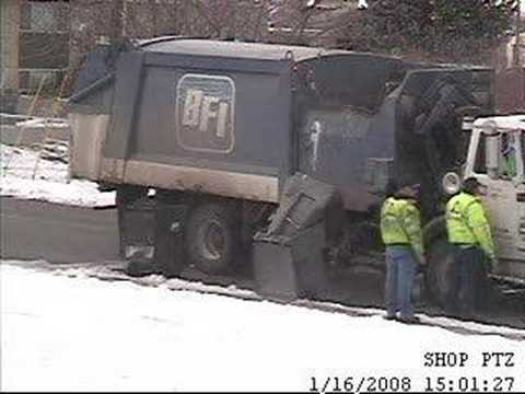Garbage men fight the garbage can