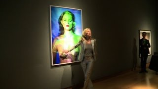 Kate Moss poses at Christie's for auction of her photos