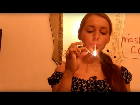 Young woman experiments with smoking