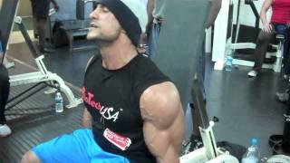 Heavyweight British Bodybuilder Serwan Aljaff training biceps and posing at Muscleworks Gym London