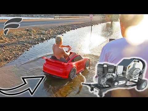 SURFING TOY CAR & SLED WITH MOTORIZED PULLEY
