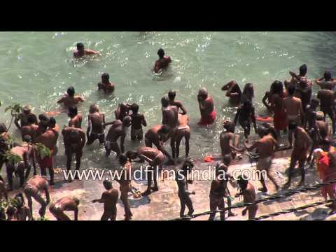 Mass dipping and bathing in the Ganges, by Hindu godmen