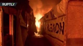 RAW: Calais 'Jungle' camp on fire after 1st day of demolition