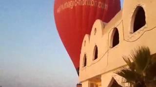 شاهد لحظات هبوط البالون الطائر بغرب الأقصر