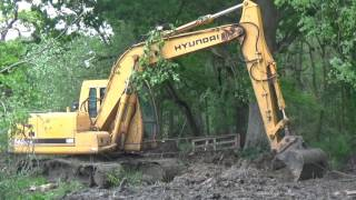 Ditch Cleaning with Hyundai Digger