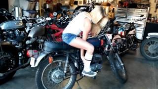 Girl kick starting a Harley Aermacchi SX 125