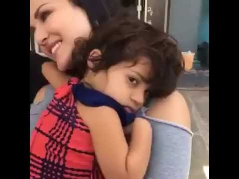 a Cute adorable little fan girl refusing to leave Sunny Leone at an event