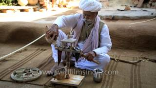 Poppy seed being prepared and opiates consumed by Bishnoi villager in Rajasthan
