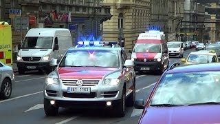 *wail, yelp, 2-tone, horn; red & blue lights* Car & Ambulance transporting patient in Prague