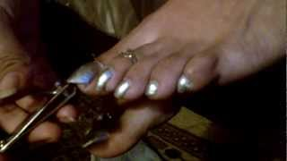 Mistress Mexi trims her long toenails and keeps for slave. Latina Femdom foot fetish