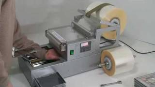 Delta300uni (universal semiautomatic overwrapping machine): for CD and DVD cases.