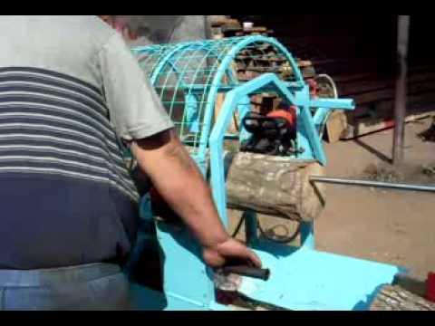 Ukrainian hydraulic firewood processor chain saw machine