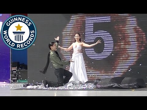 Most costume change illusions in one minute Guinness World Records