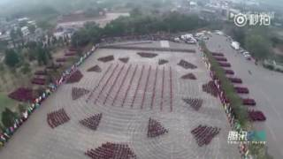 Some 30,000 martial arts students perform Kung Fu together at Int