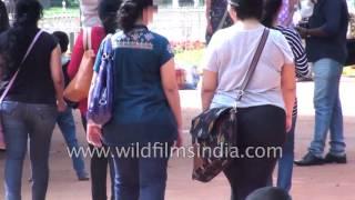 Little street boy in Bangalore slaps woman's butt