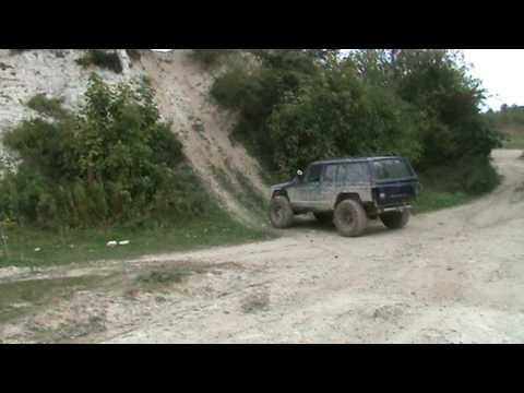 Jeep cherokee xj climbs vertical wall vidoemo for Starr motors off road