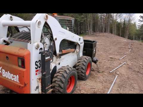 Auger Bucket goes to post holes that other equipment can not