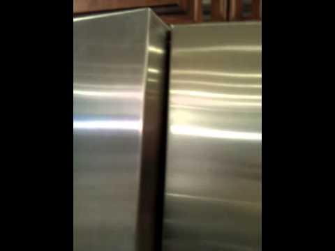 New fridge door causes freezer door to stick