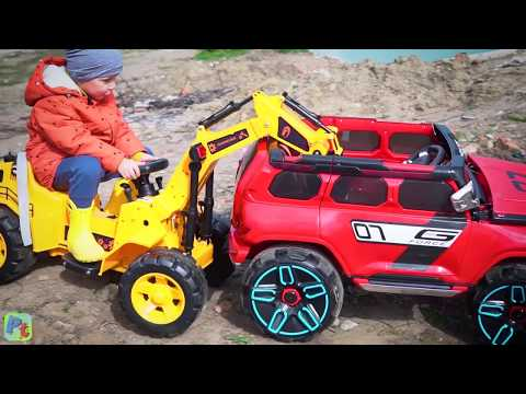 Power Wheels STUCK in the mud Funny Kid ride on Power Wheels Tractor Cars video for kids