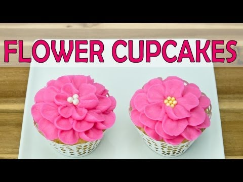 Piping Buttercream Icing Flowers on Cupcakes by Cookies Cupcakes and Cardio