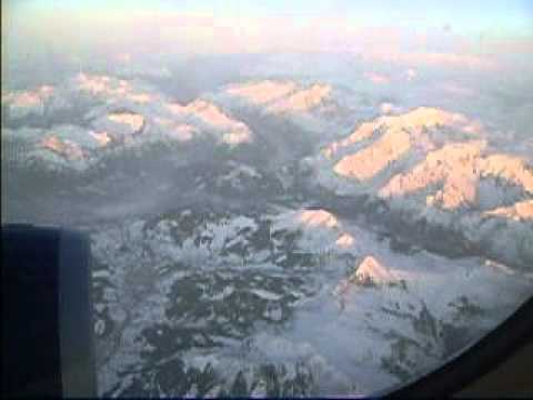 Snow on the Alps flying from London to Italy
