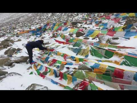 Placing Prayer Flags at the Dolma La Pass