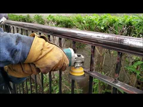 Fence rust removal. Grinder with flap disc and twisted wire cup. Fence and metal porch painting.