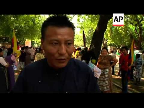 Tibetan exiles hold rally, following suicide of 2 Buddhist monks