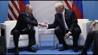 Trump and Putin meet and shake hands ahead of meeting at the G20
