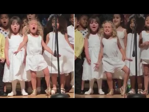 4-Year-Old Girl's Spirited Singing Steals Spotlight at Preschool Graduation