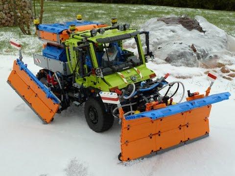Lego Unimog U400 snowplow doing the backyard