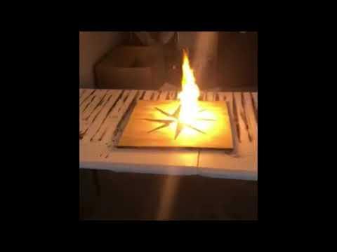 Compass woodburning with gunpowder.