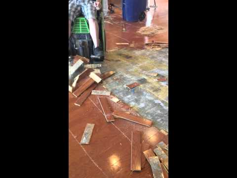 How to remove glue down wood floor