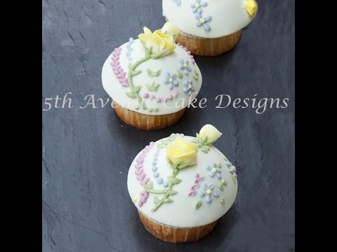 Royal Icing Roses and Blossoms Piped on a Cupcake