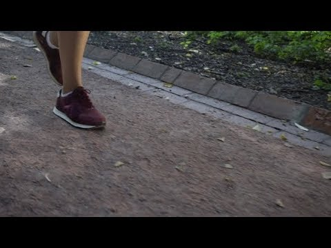 Legs of a Jogger Running in a Park | Stock Footage