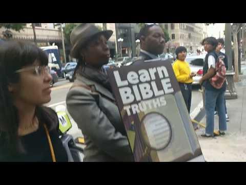TedTheAtheist vs Racist old black weird religious wacko w/ newspapers