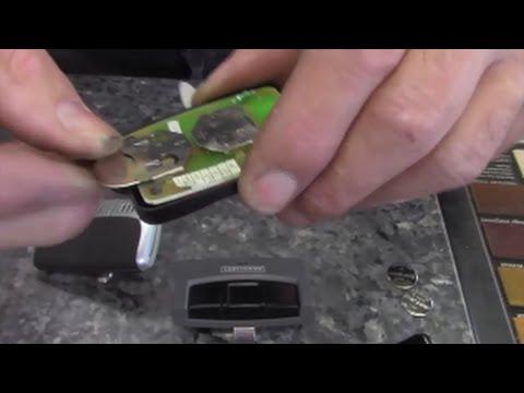 Replace battery in garage door opener wireless transmitters