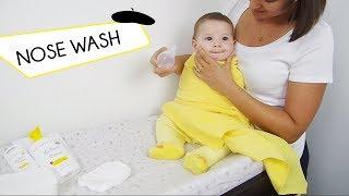 Gently wash baby