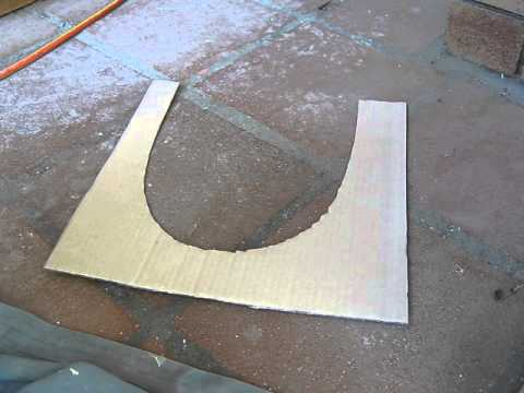 Cutting tiles around a toilet ( the floor is dished, not level )