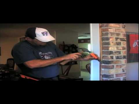 Installer Replacing a Metal Window In A Brick Wall
