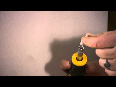 How to Put an Anchor in Drywall Without a Drill : Nails, Screws & Wall Hangings