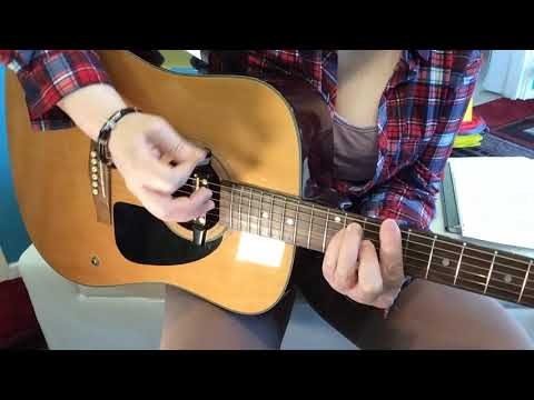How to strum a guitar for beginners using a pick guitar lesson