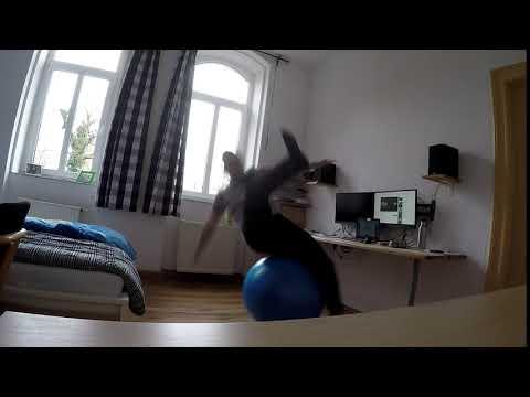 Man tries to balance on yoga ball. - 984817