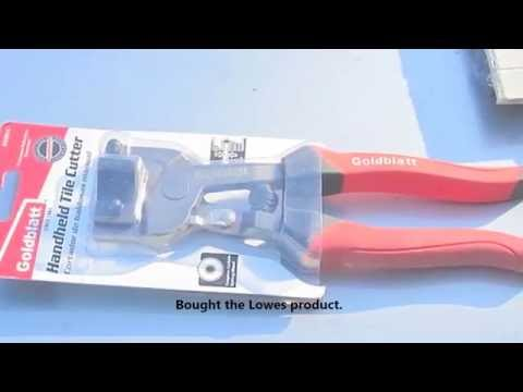 Cutting terracotta tiles with a handheld tile cutter