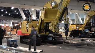 Caterpillar 323F excavator moving  out of Conexpo 2017