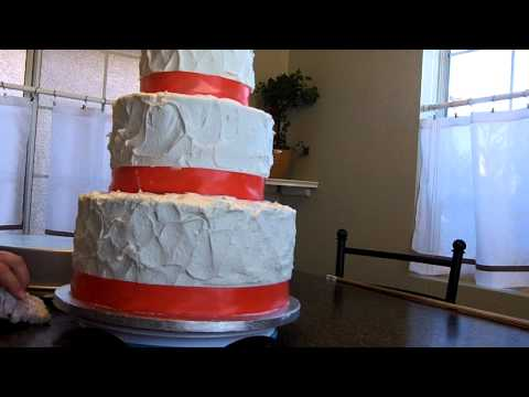 How to make a wedding cake, learn how to level, fill, stack and frost part 3 at hollysbakery.com
