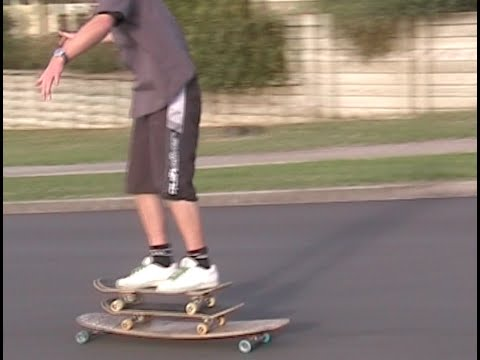 Riding Three Skate Boards Down a Hill