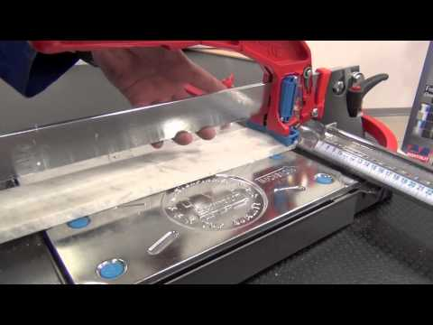 Cutting marble with manual tile cutter